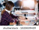 beautiful hipster woman working ... | Shutterstock . vector #1020039439