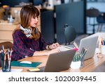 young asian designer woman... | Shutterstock . vector #1020039445