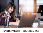 beautiful hipster woman working ... | Shutterstock . vector #1020039451