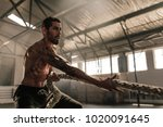 strong man pulling heavy rope... | Shutterstock . vector #1020091645
