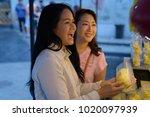 portrait of two mature asian... | Shutterstock . vector #1020097939