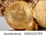 Small photo of Closeup of golden bitcoin as main cryptocurrency with gold lumps being blurred on background. Blockchain digital electronic virtual money finance banking futuristic trend innovation