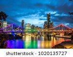 Brisbane, Queensland / Australia - January 23 2018: Story Bridge lit up in rainbow colours reflecting on the Brisbane river