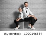 father and son in elegant suits ... | Shutterstock . vector #1020146554