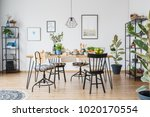 lamp above wooden table and... | Shutterstock . vector #1020170554