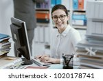 young smiling secretary working ... | Shutterstock . vector #1020178741