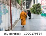 january 2018.  a monk walking... | Shutterstock . vector #1020179599