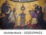 Small photo of TURIN, ITALY - MARCH 15, 2017: The symbolic fresco of The adoration of holys in front of Eucharist in church Chiesa di San Dalmazzo by Enrico Reffo (1831-1917).