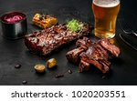 pork ribs in barbecue sauce and ... | Shutterstock . vector #1020203551