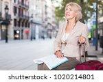 elegant adult tourist woman is... | Shutterstock . vector #1020214801