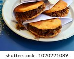 Small photo of Arepas filled with shredded beef. Venezuelan typical dish.Traditional Colombian food.Arepa is a popular breakfast and snack in Latin American countries.Selective focus.