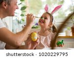 a father and daughter... | Shutterstock . vector #1020229795