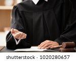 male judge demanding bribe ... | Shutterstock . vector #1020280657