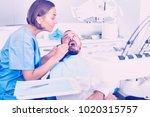 glad  stomatologist girl in... | Shutterstock . vector #1020315757