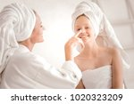 mother and daughter. delighted... | Shutterstock . vector #1020323209