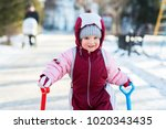 little child is playing in the... | Shutterstock . vector #1020343435