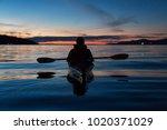 man kayaking on a sea kayak... | Shutterstock . vector #1020371029