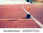 gold trophy cup is winner in a... | Shutterstock . vector #1020377221