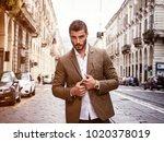 attractive man outdoor wearing... | Shutterstock . vector #1020378019
