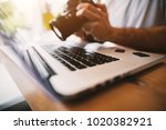 very close shot of laptop and... | Shutterstock . vector #1020382921