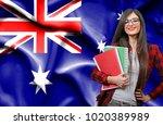 happy female student holdimg...   Shutterstock . vector #1020389989