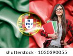happy female student holdimg...   Shutterstock . vector #1020390055