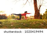stretching muscle  young female ... | Shutterstock . vector #1020419494