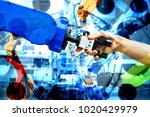handshake of robotic and human... | Shutterstock . vector #1020429979