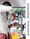 Small photo of Kuala Lumpur, Malaysia - September 25th, 2016 : Barista was seen preparing a drink in an Airstream cafe in Ampang, Kuala Lumpur.