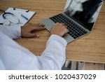 young doctor sitting working... | Shutterstock . vector #1020437029
