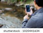 man hand holding smartphone... | Shutterstock . vector #1020441634
