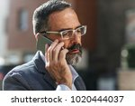 middle aged caucasian serious... | Shutterstock . vector #1020444037