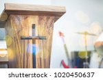 Small photo of cloe up of the pulpit with Jesus cross in church service, can be used for christian background
