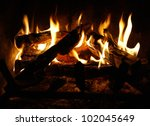Fire And Flames In A Fireplace...
