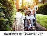 an elderly man is sitting in a... | Shutterstock . vector #1020484297