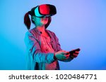 young girl experiencing vr... | Shutterstock . vector #1020484771