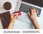 top view of man using credit...   Shutterstock . vector #1020500191
