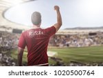 russian fan celebrating in the... | Shutterstock . vector #1020500764