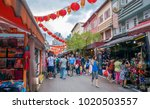 people walking through a... | Shutterstock . vector #1020503557