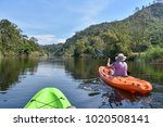 tourists kayaking or canoeing... | Shutterstock . vector #1020508141