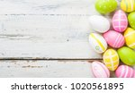 colorful easter eggs on a white ... | Shutterstock . vector #1020561895