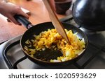 stir the onion with spices ... | Shutterstock . vector #1020593629