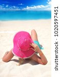 girl with a hat on the beach... | Shutterstock . vector #1020597451