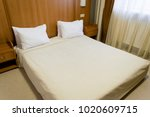 comfortable bed with white...   Shutterstock . vector #1020609715