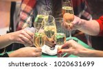 clinking glasses with white... | Shutterstock . vector #1020631699