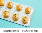 orange pills and funny faces in ...   Shutterstock . vector #1020641401