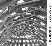 Small photo of Stunning interior structure. Industrial iron roofing skeleton of an old shipping yard. Light beautiful airy space. Chatham, Kent.
