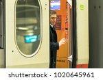 traveler getting off the train | Shutterstock . vector #1020645961