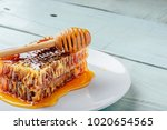 delicious honeycomb on white... | Shutterstock . vector #1020654565