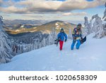 two happy snowboarders  with... | Shutterstock . vector #1020658309